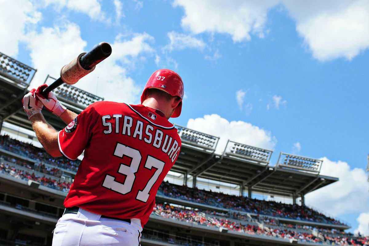 August 5, 2012;Washington D. C., USA; Washington Nationals pitcher Stephen Strasburg (37) warms up on deck during the game against the Miami Marlins at Nationals Park. Mandatory Credit: Evan Habeeb-US PRESSWIRE