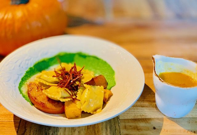 A white plate with the pumpkin agnolotti on it at Julep