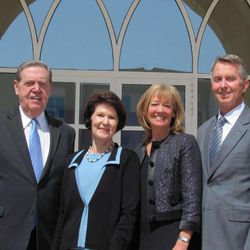 Elder Jeffrey R. Holland and his wife Patricia stand with Elder Larry S. Kacher and his wife Pauline outside the Abu Dhabi stake center.
