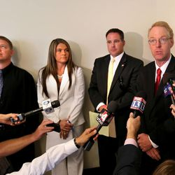 Shaun Cowley, a former West Valley police officer who shot and killed Danielle Willard, 21, in November 2012 with his attorneys Lindsay Jarvis, Bret Rawson and Sam Cassell, left to right, believe he should never have been charged, Monday, July 28, 2014, in Salt Lake City.
