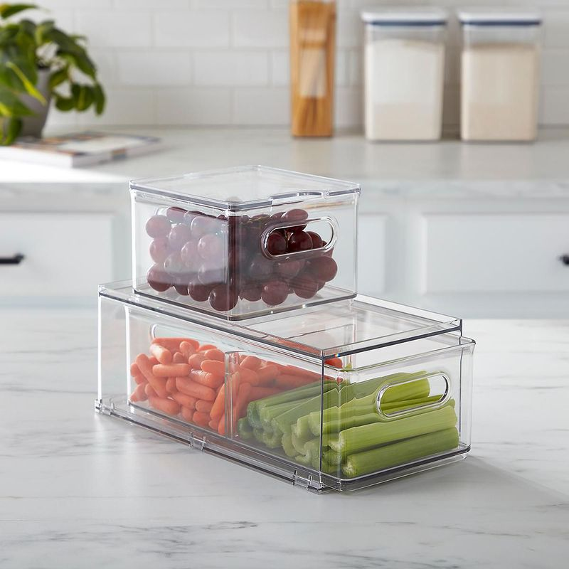 Clear rectangular and square boxes holding fruits and vegetables.