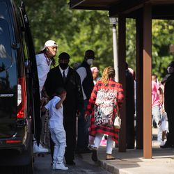 Deandre Wilson, left, the father of DaJore Wilson, gets out of a truck outside Abundant Living Christian Center in Dolton, Ill. during the wake and funeral of eight-year-old DaJore Friday morning, Sept. 18, 2020. DaJore Wilson was fatally shot in Canaryville Sept. 7.
