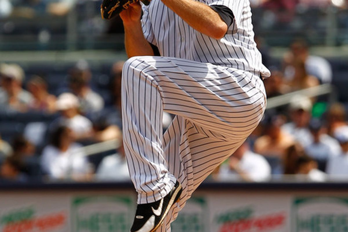 Apr. 14, 2012; Bronx, NY, USA; New York Yankees starting pitcher David Phelps (41) pitches during the fourth inning against the Los Angeles Angels at Yankee Stadium. Mandatory Credit: Debby Wong-US PRESSWIRE