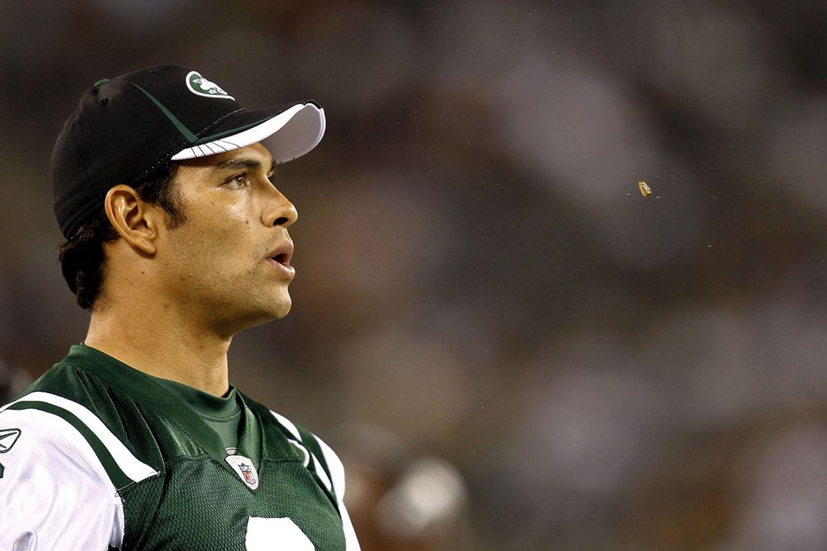 EAST RUTHERFORD, NJ - SEPTEMBER 01:  Mark Sanchez #6  of the New York Jets spits out a sunflower seed during their pre-season game at MetLife Stadium on September 1, 2011 in East Rutherford, New Jersey.  (Photo by Jeff Zelevansky/Getty Images)