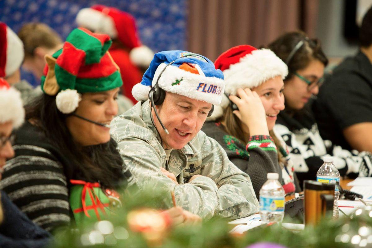 NORAD Santa Tracker participants help answer phone calls during the Christmas season.