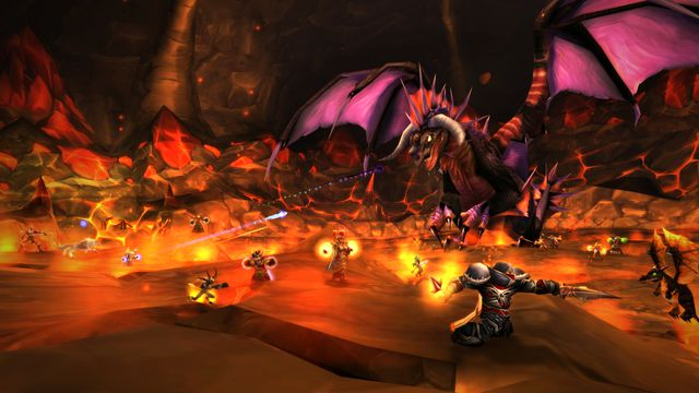 A dragon fighting World of Warcraft characters