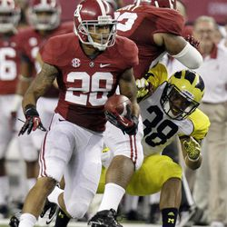 Alabama defensive back Dee Milliner (28) runs back a turnover as teammate Brandon Ivory (62) puts a block on Michigan running back Thomas Rawls (38) during the first half of an NCAA college football game at Cowboys Stadium in Arlington, Texas, Saturday, Sept. 1, 2012.