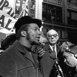 At a rally outside the U.S. Courthouse Oct. 29, 1969, Dr. Benjamin Spock, background, listens to Fred Hampton, chairman of the Illinois Black Panther party at a protest against the trial of eight persons accused of conspiracy to cause a riot during the Democratic National Convention in 1968.