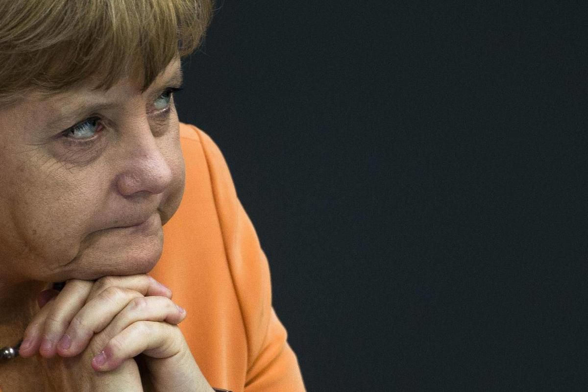 German Chancellor Angela Merkel attends the the first session of the budget 2013 debate at the parliament Bundestag in Berlin, Germany, Tuesday, Sept. 11, 2012. On Wednesday Merkel and her government face a rule of Germany's Federal Constitutional Court a