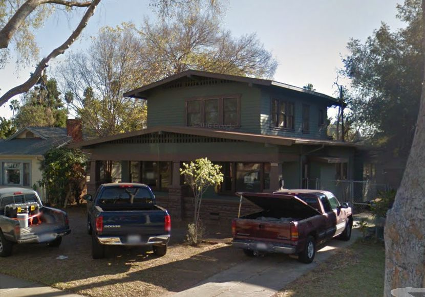 Green two-story Craftsman