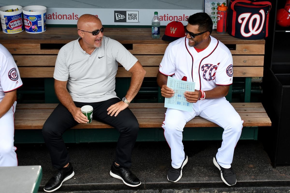 Manager Dave Martinez of the Washington Nationals talks with General Manager Mike Rizzo before the game against the Kansas City Royals at Nationals Park on July 7, 2019 in Washington, DC.