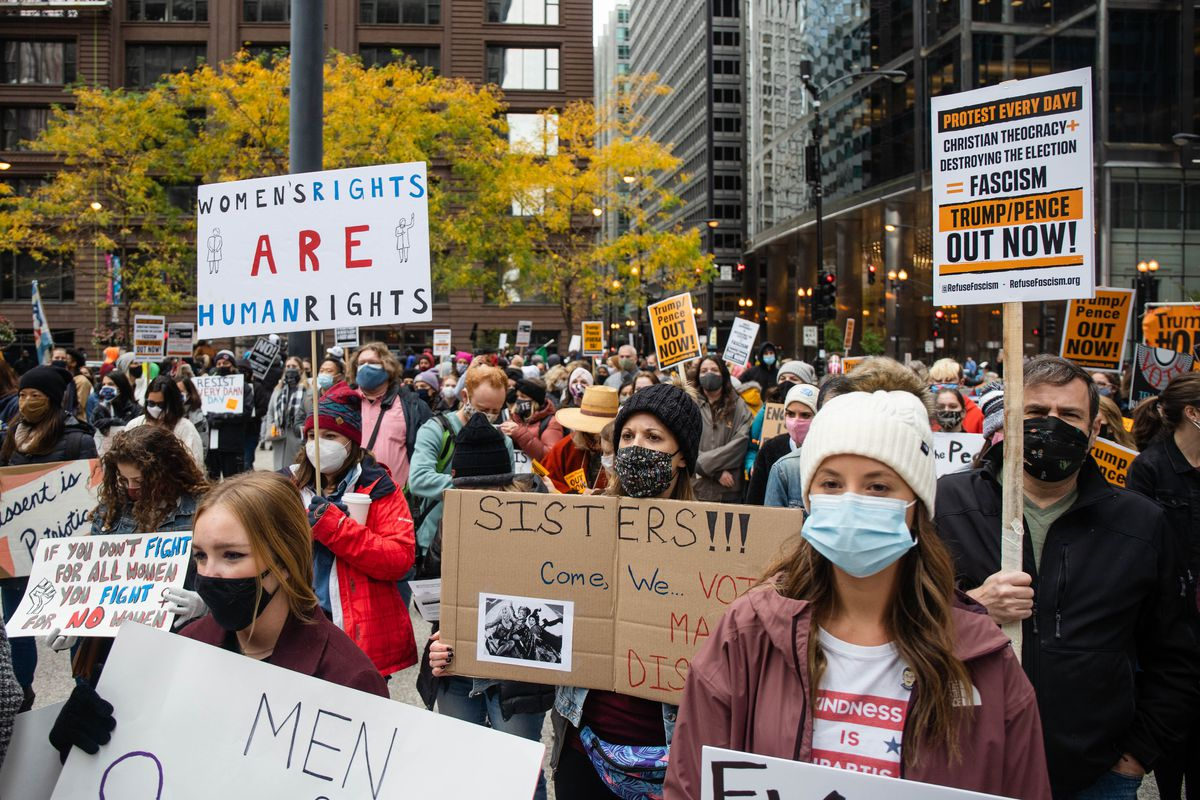 Hundreds of people participate in the Women's March, which aims to rally voters, at Federal Plaza in the Loop Saturday morning, Oct. 17, 2020.