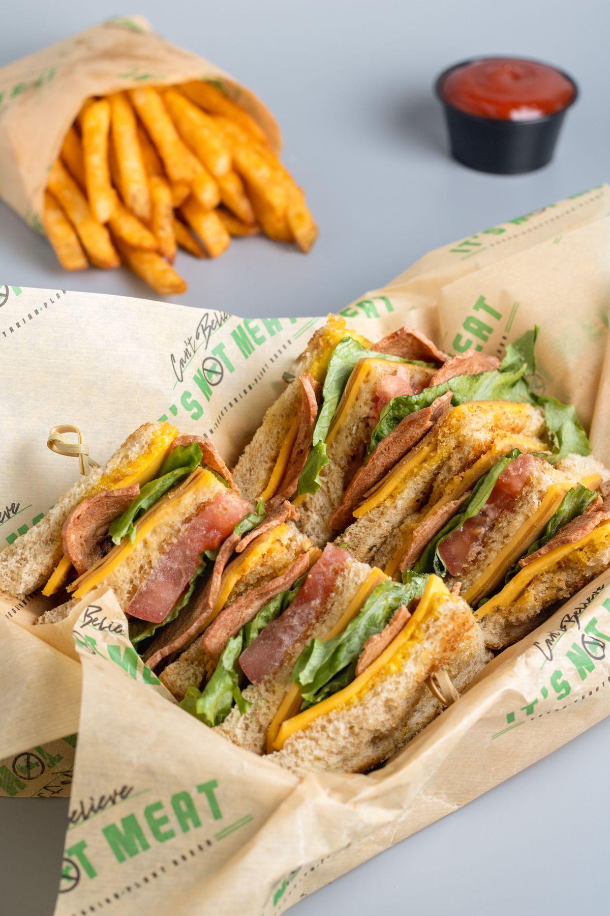 A vegan triple-decker club sandwich