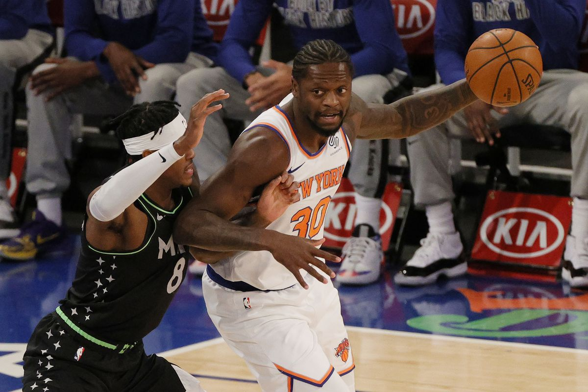 Julius Randle of the New York Knicks dribbles against Jarred Vanderbilt of the Minnesota Timberwolves during the first half at Madison Square Garden on February 21, 2021 in New York City.