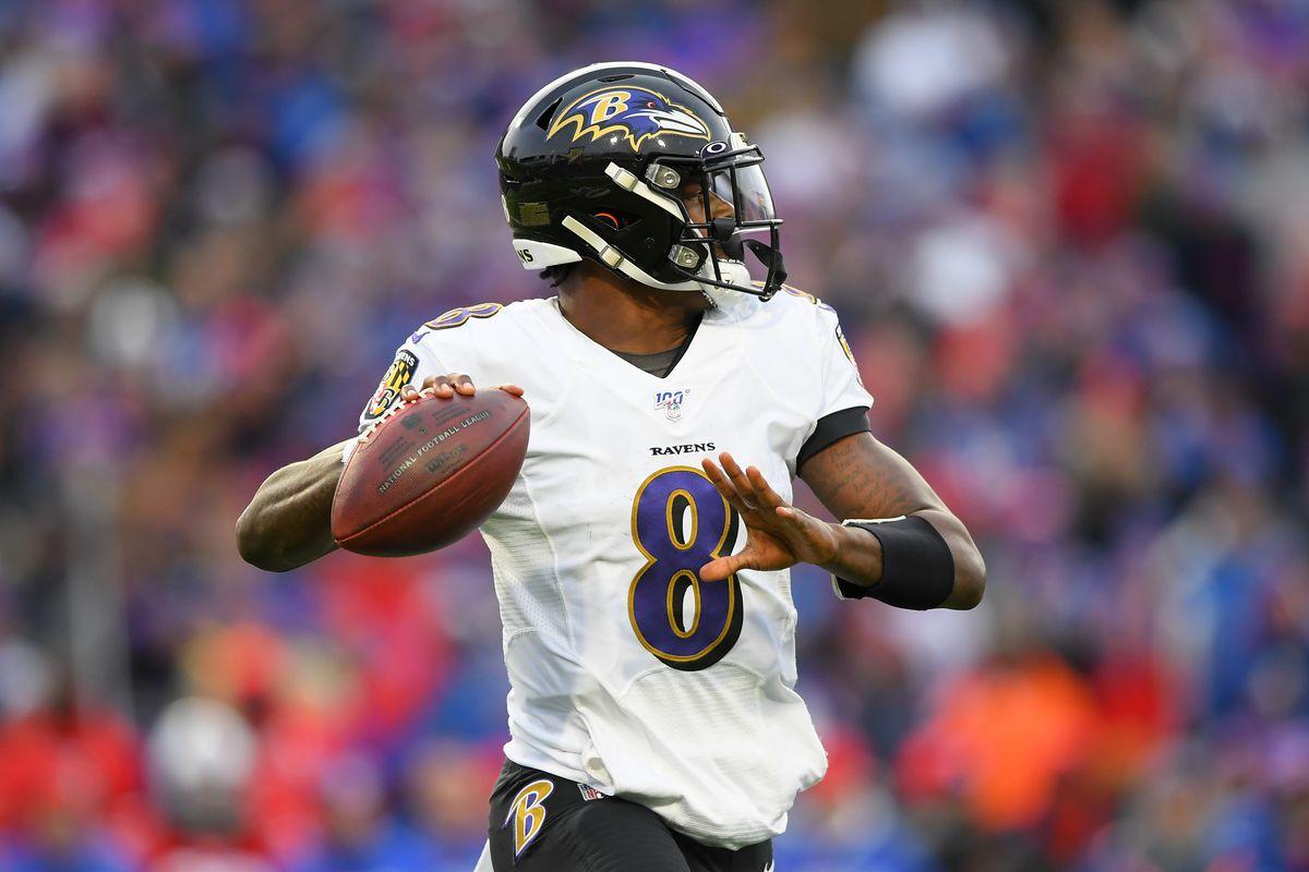 Baltimore Ravens quarterback Lamar Jackson passes the ball against the Buffalo Bills during the fourth quarter at New Era Field.