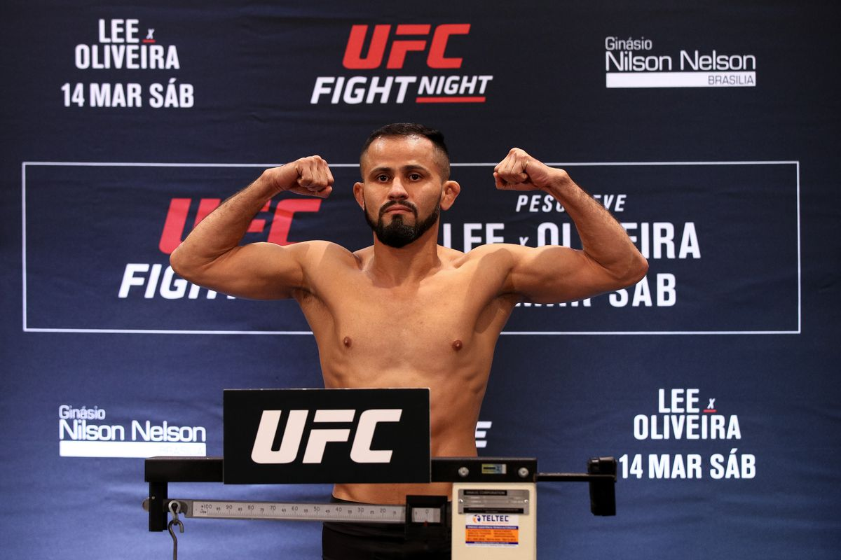 Jussier Formiga of Brazil poses on the scale during the UFC Fight Night Lee v Oliveira weigh-in at Windsor Plaza Hotel on March 13, 2020 in Brasilia, Brazil.