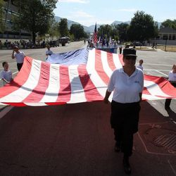 The Lake Ridge Elementary Honor Guard marches in the Days of '47 Youth Parade in Salt Lake City on Saturday, July 20, 2013.