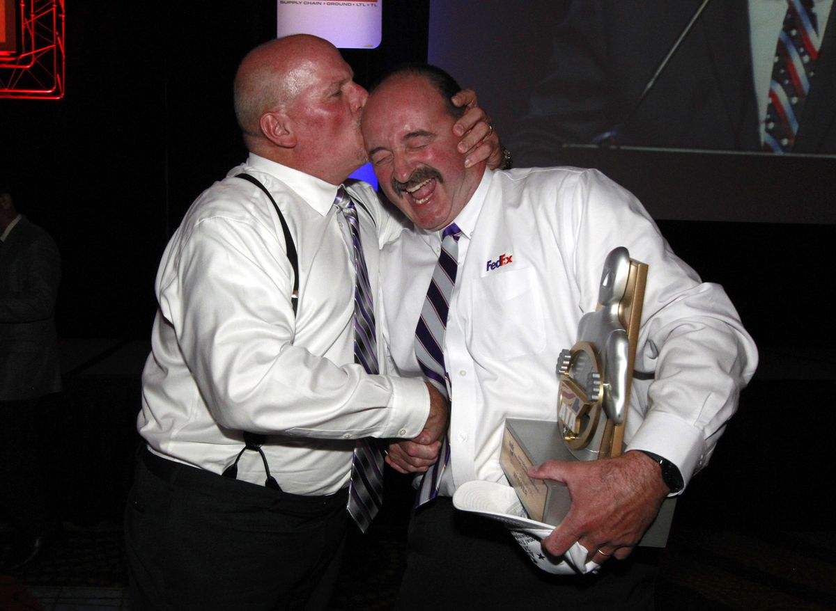 Roland Bolduc, right, celebrates being named Grand Champion