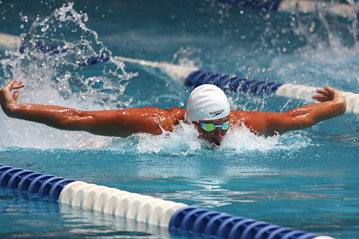 Mar 29, 2012; Indianapolis, IN, USA; Ryan Lochte swims the 100 meter butterfly during the Indianapolis Grand Prix at the Indiana University Natatorium.  Mandatory Credit: Brian Spurlock-US PRESSWIRE