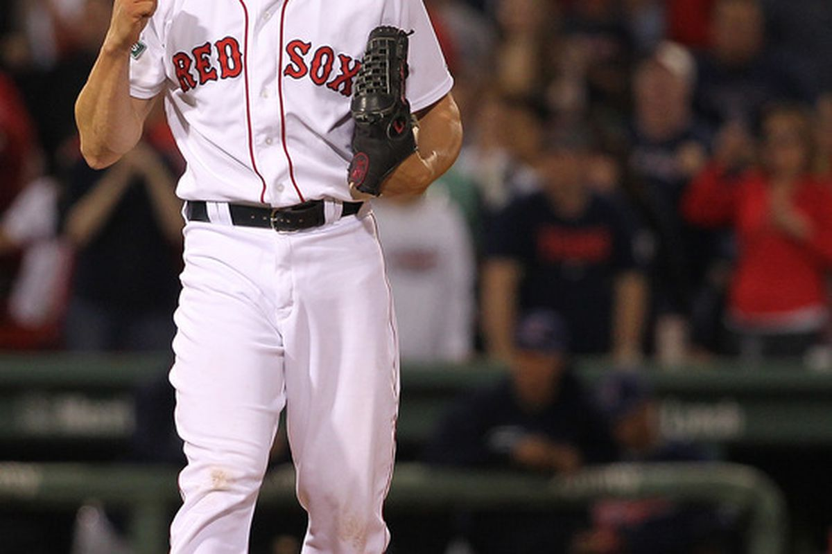 BOSTON, MA - MAY 12:  Alfredo Aceves #91 of the Boston Red Sox reacts after a win against Cleveland Indians at Fenway Park May 12, 2012  in Boston, Massachusetts. (Photo by Jim Rogash/Getty Images)
