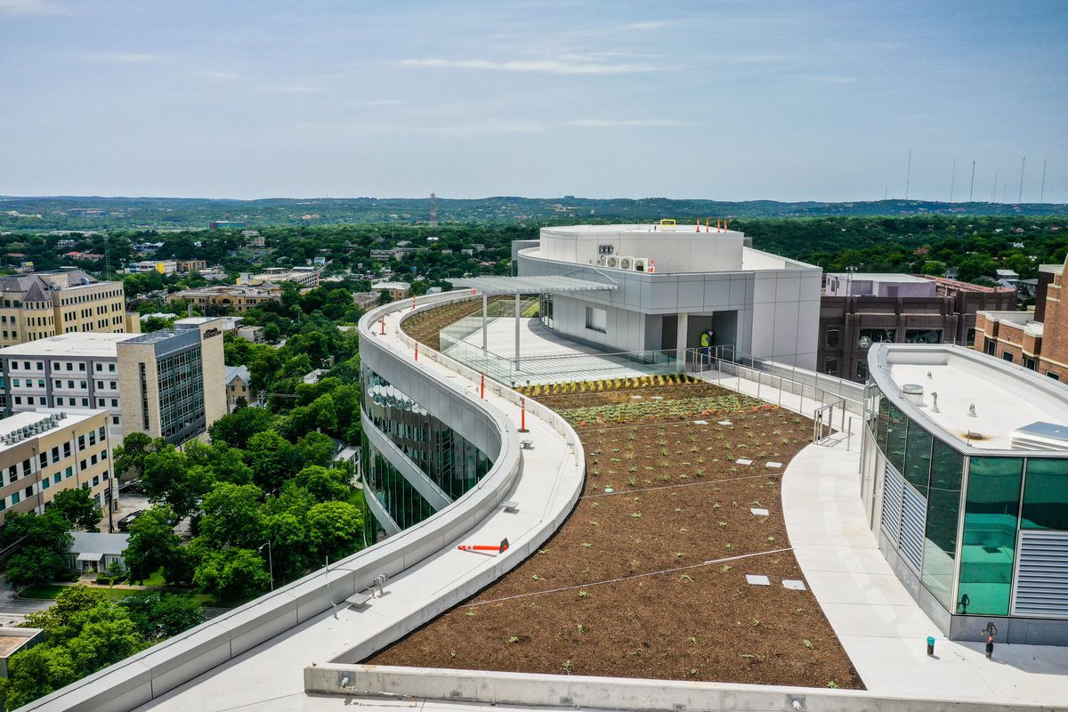 Curving rooftop, new garden beds, patio with pergola, overlooking downtown, Hill Country on horizon