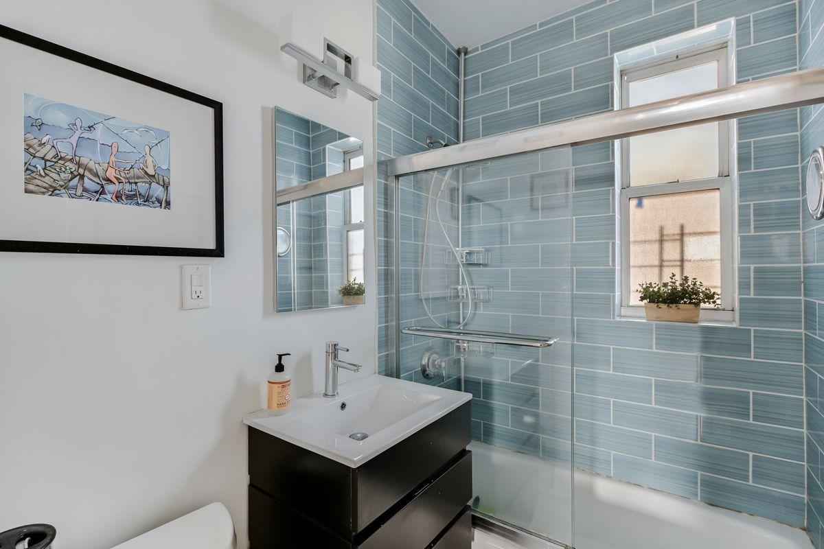 A bathroom with blue tiles.