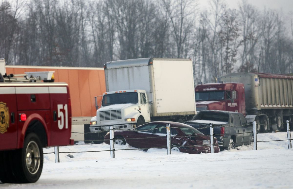 <small><strong>Vehicles rest along the median at the scene of a series of crashes along Interstate 94, Friday, Jan. 9, 2015, between mile markers 88 and 92 in eastern Kalamazoo County, near Galesburg, Mich. State police say at least one person has died in