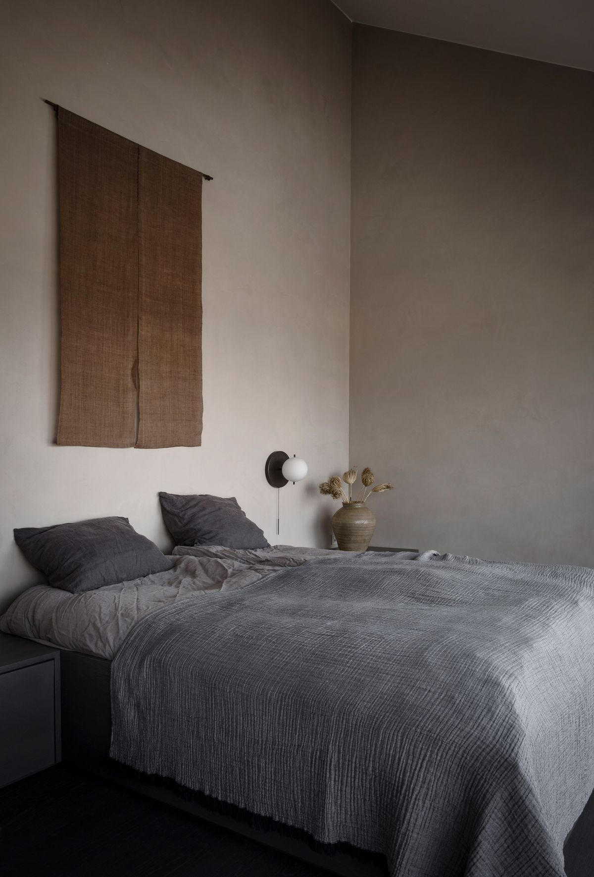 Bed with burlap art hanging on the wall