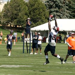 Denver Broncos rookie running back Montee Ball leaps for a Pass during day two of training camp.