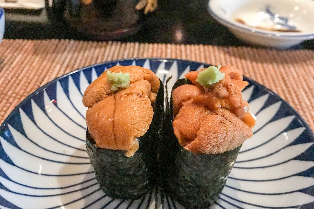 Two kinds of uni at Kura Sushi, West Hollywood on a blue and white plate at the counter.