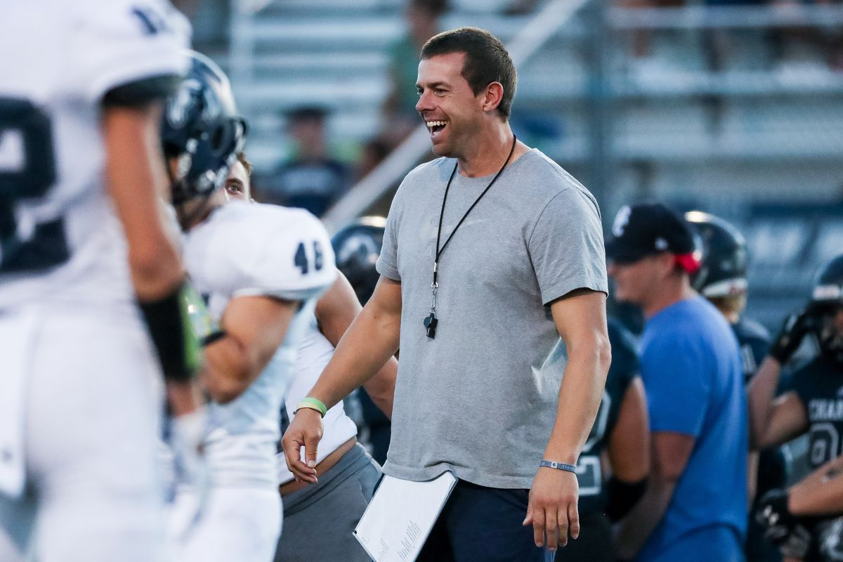 Head coach Eric Kjar warms up with players as Corner Canyon football hosts its annual intrasquad scrimmage in Draper on Friday, Aug. 7, 2020.