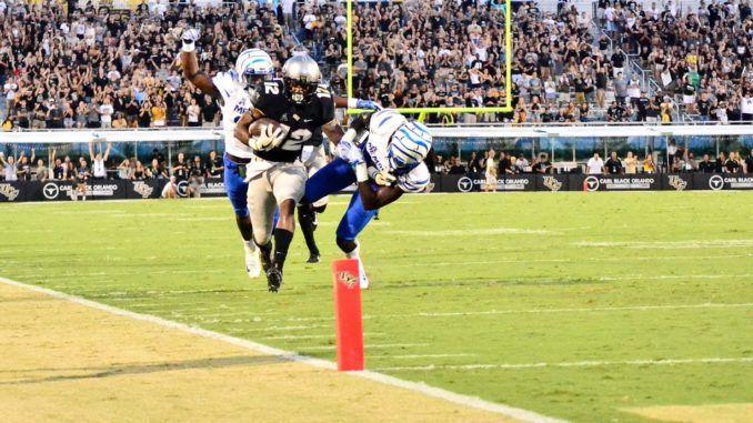 Taj McGowan carrying the ball towards the end zone against Memphis (Photo: Derek Warden)