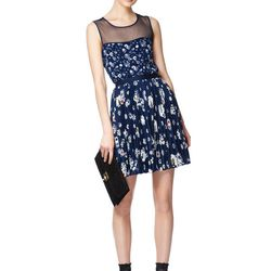 Look 9: Sleeveless Top with Sheer Panel in Navy Floral, $26.99 Pleated Skirt in Navy Floral, $29.99 Also Available in Solid Black Lace Clutch in Black, $29.99