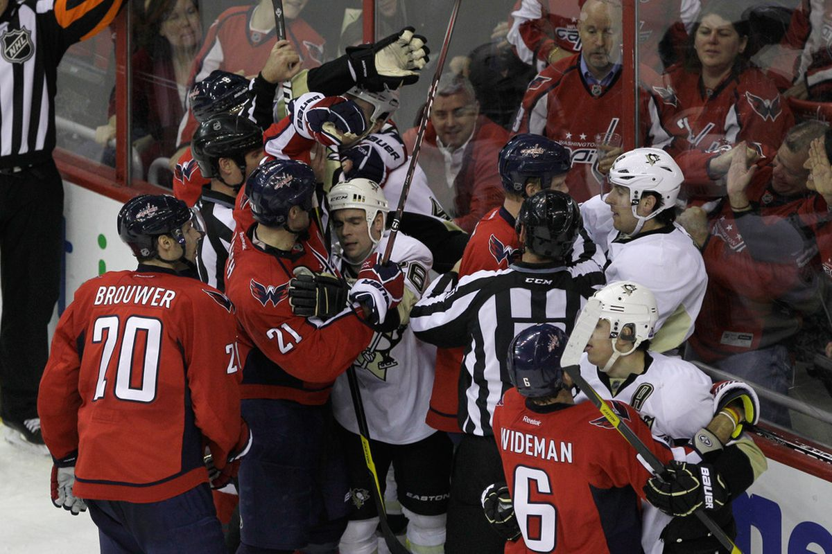 WASHINGTON, DC - DECEMBER 01: Members of the Washington Capitals and Pittsburgh Penguins are separated during the third period at Verizon Center on December 1, 2011 in Washington, DC.  (Photo by Rob Carr/Getty Images)