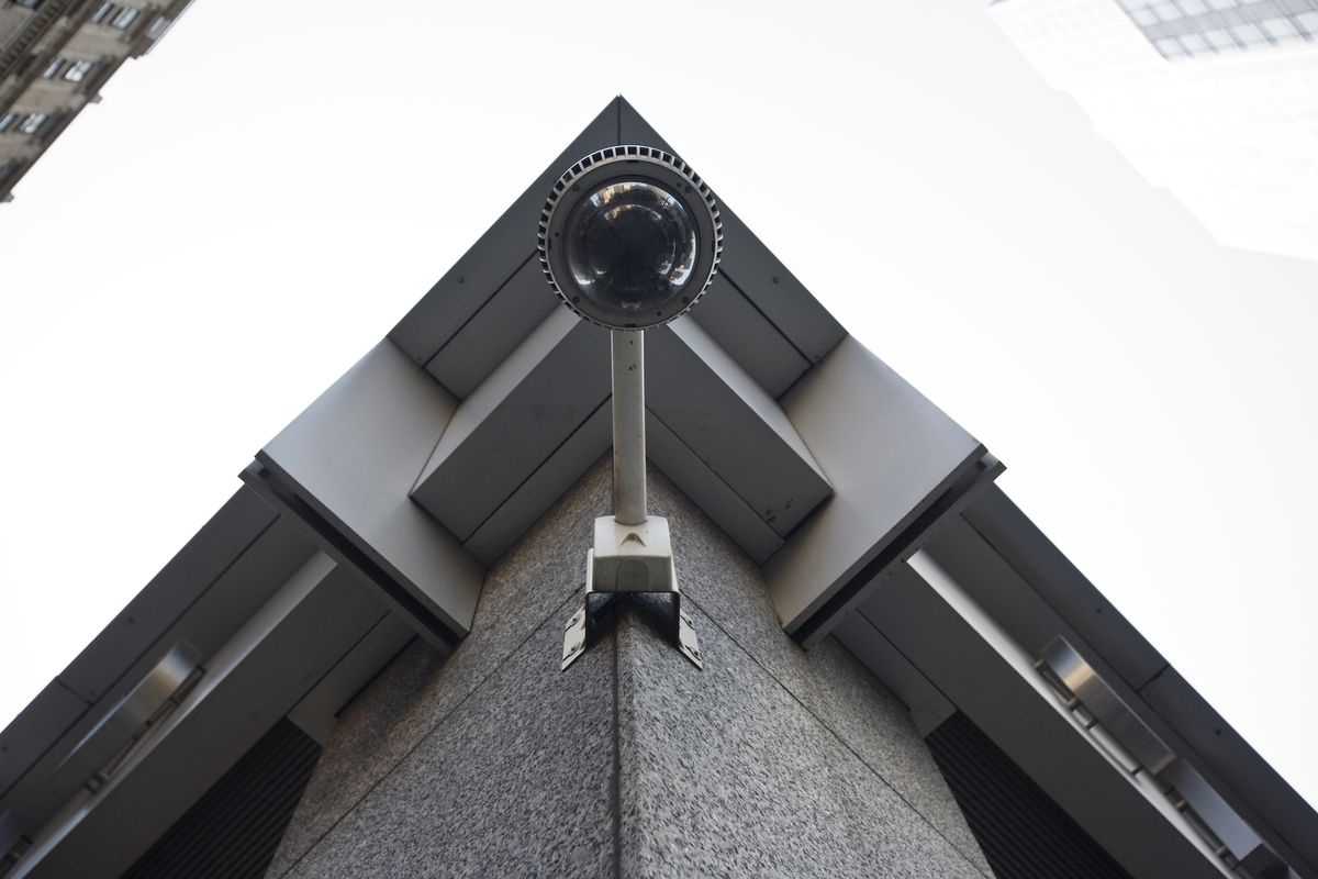 A CCTV security camera is mounted on a building in midtown Manhattan.