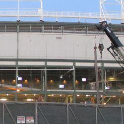 West side of ballpark showing color-bar patterns on TV monitors -