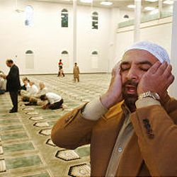 Tarek Nosseir calls others to prayer at an interfaith worship service at the Khadeeja Islamic Center in West Valley City. Faiths across the country came together for similar ceremonies.