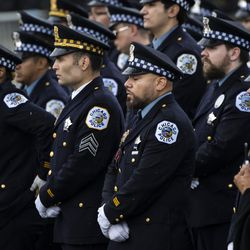 Hundreds of Chicago police officers and other law enforcement officers gather outside St. Rita of Cascia Shrine Chapel during the funeral for Officer Ella French, Thursday, Aug. 19, 2021. French was fatally shot and her partner was critically wounded while in the line of duty on Aug. 7 in West Englewood.