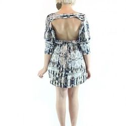"""Accidents happen, and sometimes a waiter drops a platter of pesto chicken on the front of your dress. If the charming print of this dress doesn't distract partygoers from that unfortunate mishap, the gorgeous backless feature will. $126 at <a href=""""http:/"""