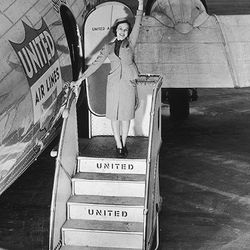 """10 years later, the cape disappeared. Photo via <a href-""""http://www.uahf.org/ua_flight_attendants_fashions.asp"""">UAHF.org.</a>"""