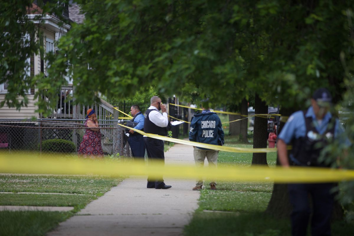 Police on the scene in Chicago Lawn Monday, where a 3-year-old girl was grazed by a bullet in the 6500 block of South Claremont Avenue.