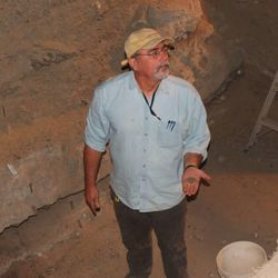Assistant state archaeologist Ron Rood shows a bit of an artifact found inside Danger Dave.