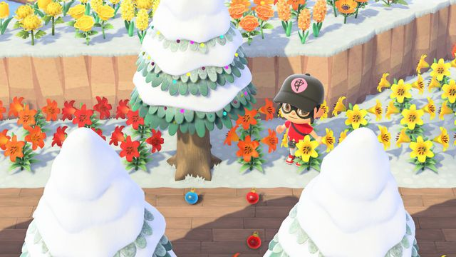 Colorful ornaments scatter the floor under a pine tree in Animal Crossing: New Horizons