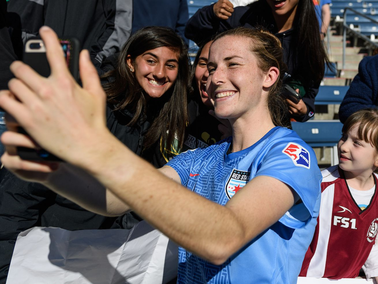 Tierna Davidson takes a selfie with fans following the Red Stars 2019 home opener.