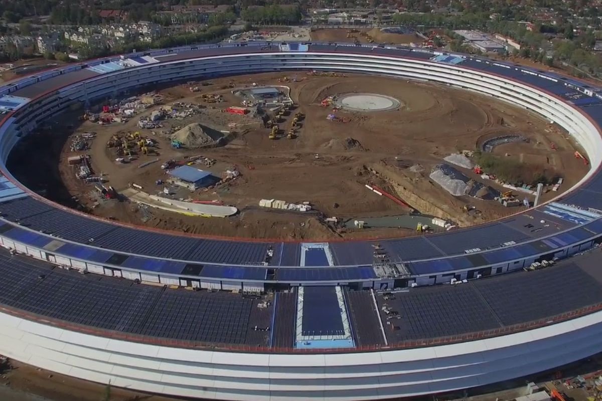 The Apple Campus II (a four-story, ring-shaped building) as it appeared under construction in July.