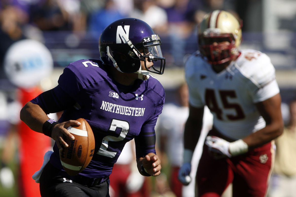 Sep 15, 2012; Evanston, IL, USA; Northwestern Wildcats quarterback Kain Colter (2) scrambles away from Boston College Eagles defensive end Mehdi Abdesmad (45) during the first quarter at Ryan Field.  Mandatory Credit: Jerry Lai-US PRESSWIRE