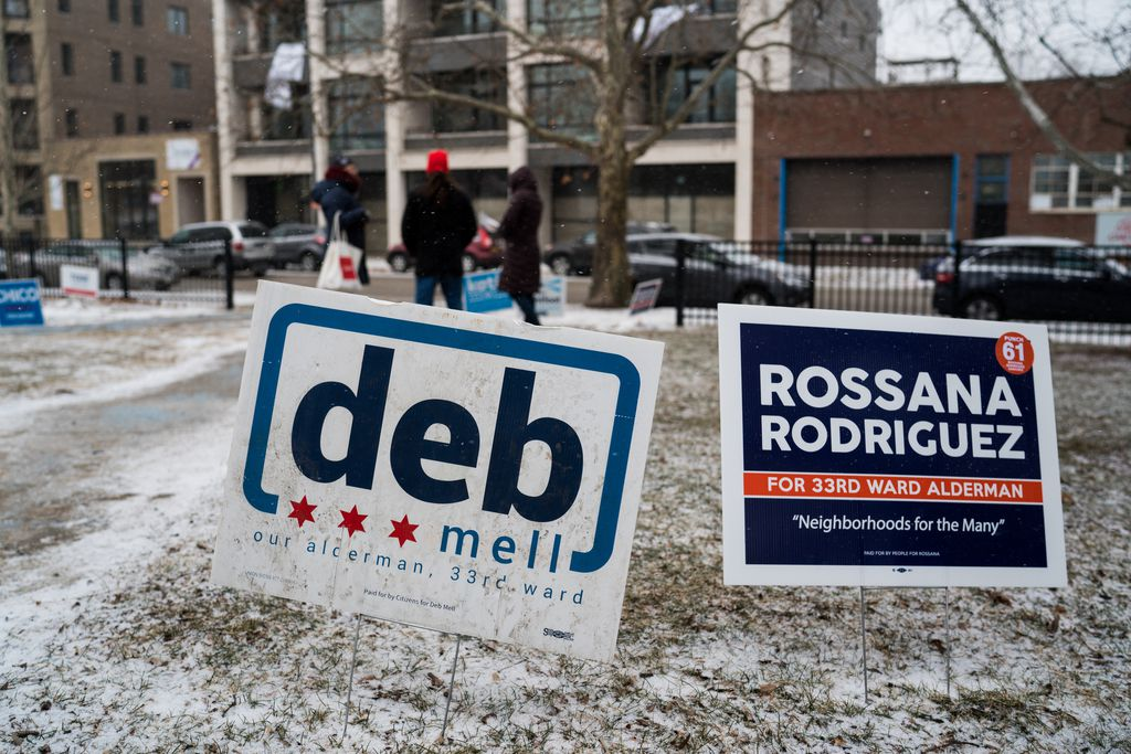 Signs for 33rd Ward aldermanic rivals Deb Mell and Rossana Rodriguez are seen side by side in Horner Park on February 26, 2019. | Max Herman/For the Sun-Times