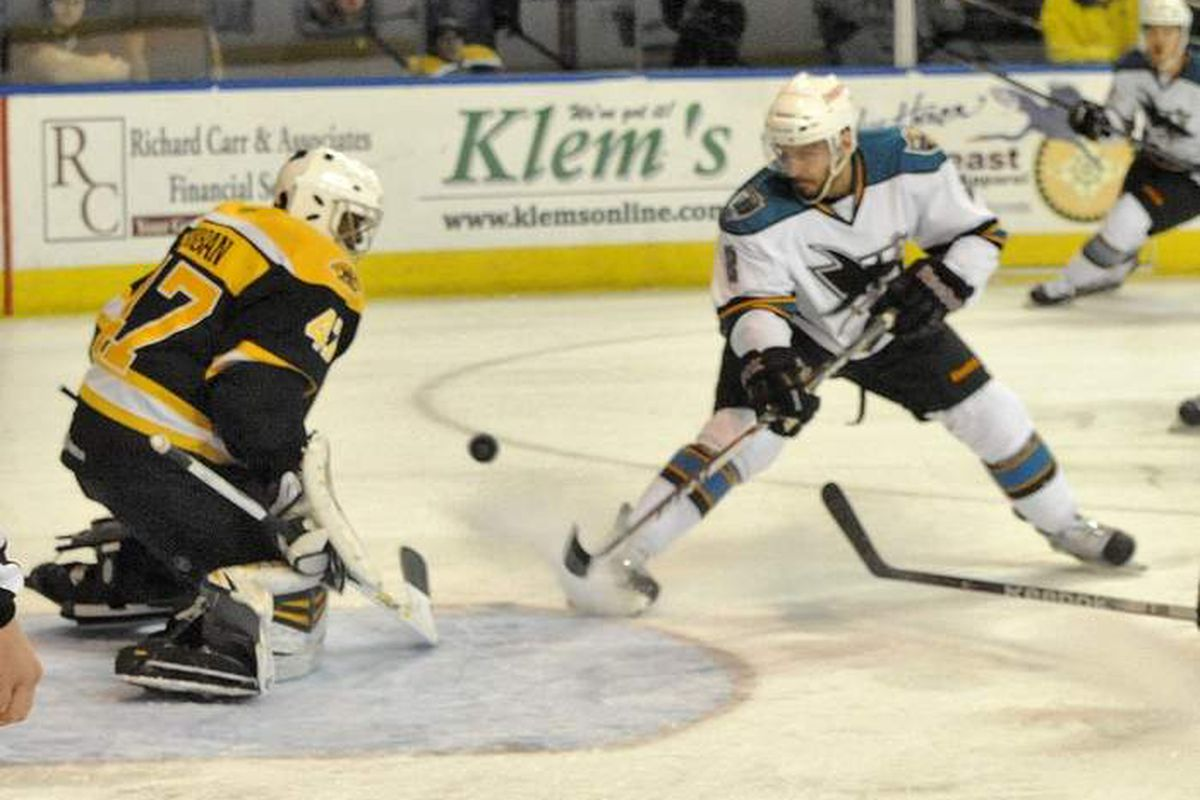 Worcester Sharks rookie defenseman Dylan DeMelo fires a backhanded shot at Providence Bruins rookie goaltender Malcolm Subban during regulation Saturday night at the DCU Center.