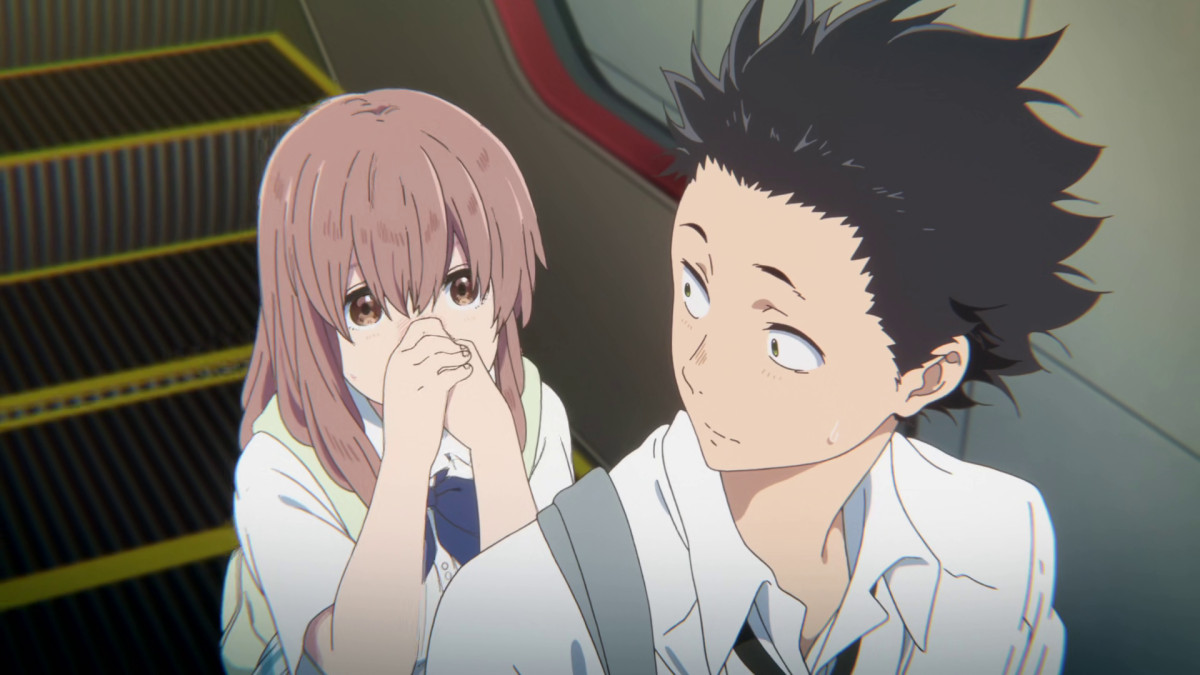 Shoko Nishimiya holds her nose as Shoya Ishida stares back at her in A Silent Voice