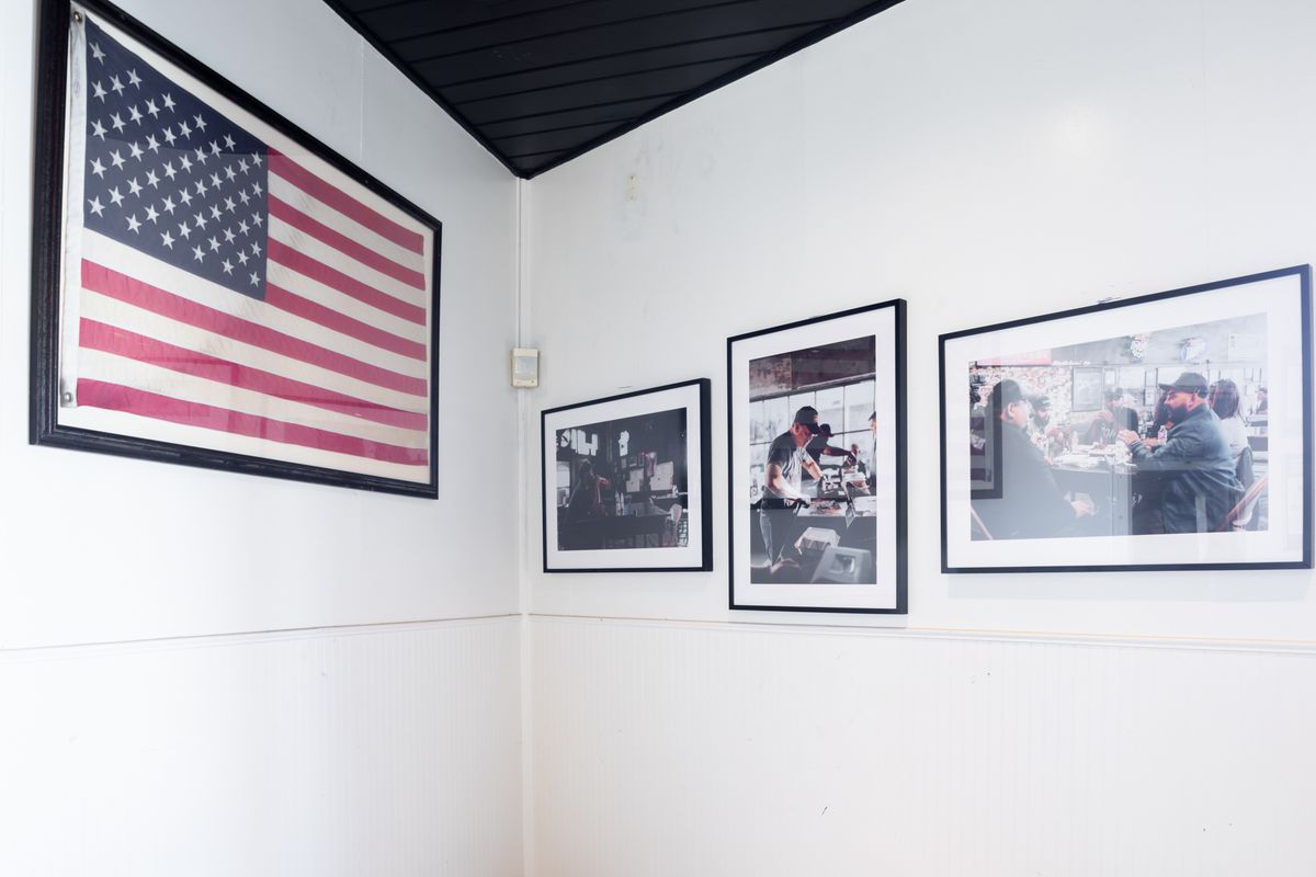Framed photos of past pop-ups (and an American flag) line the walls